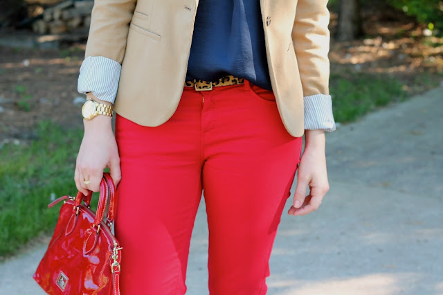 navy blouse, red pants, camel blazer, dooney and burke bag, leopard belt, leopard flats