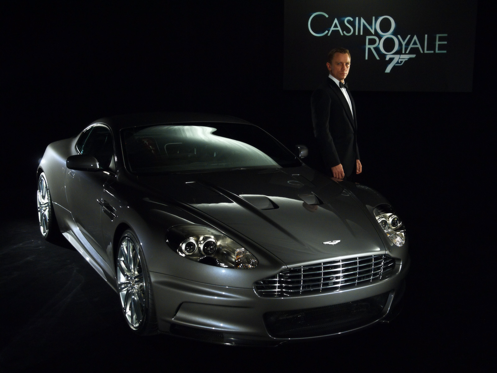 http://1.bp.blogspot.com/-ULueIuUe6X4/TY1ly3OemnI/AAAAAAAAALU/MDElOC_hkk0/s1600/aston-martin-dbs-james-bond-wallpaper.jpg