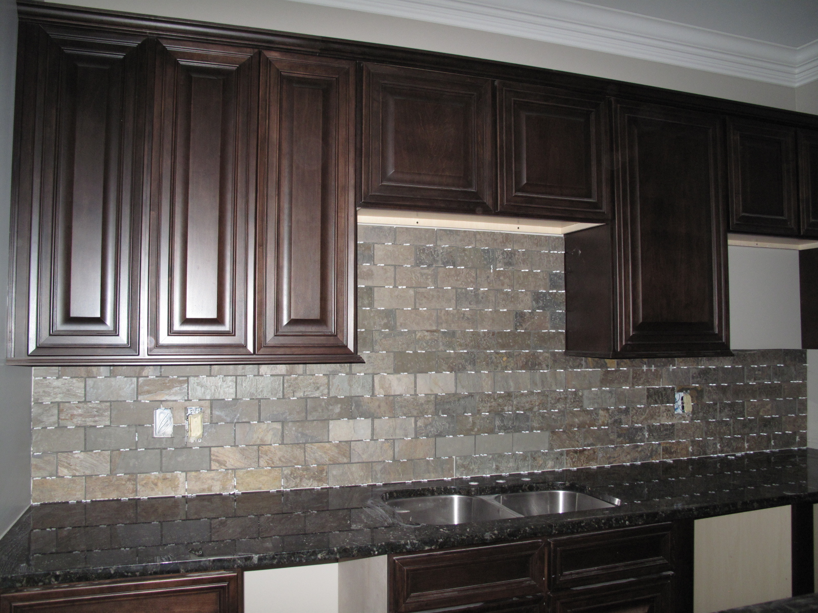 Backsplash on pinterest slate backsplash dark cabinets for Black kitchen backsplash ideas