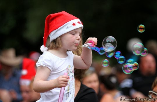 Jean-Anne Harrison, 4, Hastings, blowing bubbles at Christmas in Cornwall Park, Hastings, an annual fun day and carol singing concert, put on by Hastings District Council photograph