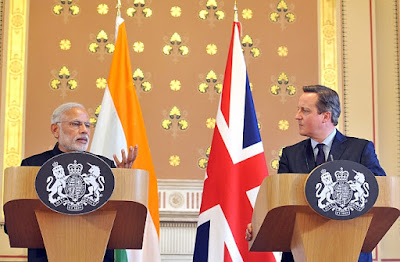 PM Modi, who avoids interacting with the press in India, had to face tough questions during his ongoing visit to UK.  A video of the joint press conference with PM Cameron shows Modi handling competently, though not comfortably, questions lobbed at him first by BBC and then The Guardian reporters.  After brief statements from PMs Cameron and Modi, the first question came from the BBC reporter. He asked why India was becoming increasingly intolerant.