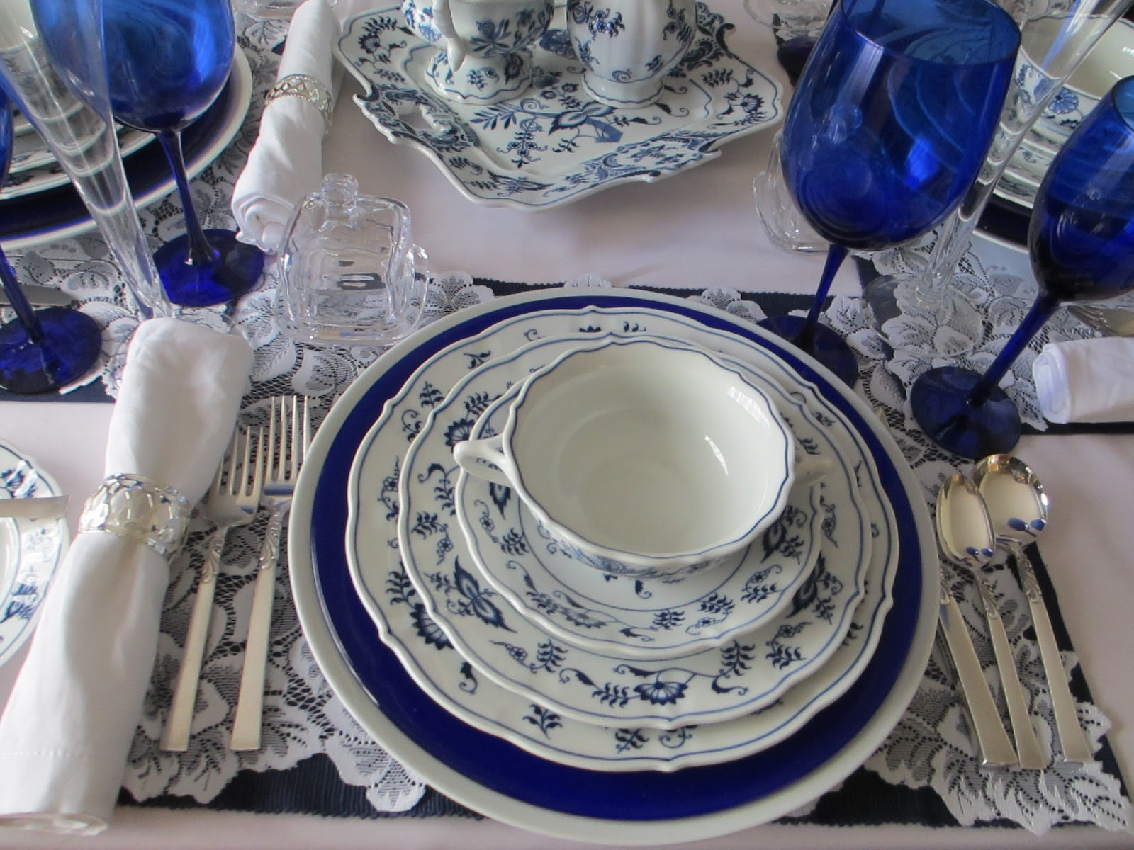 Inidual butter holders at each place setting & The Welcomed Guest: Blue Danube Birthday Party