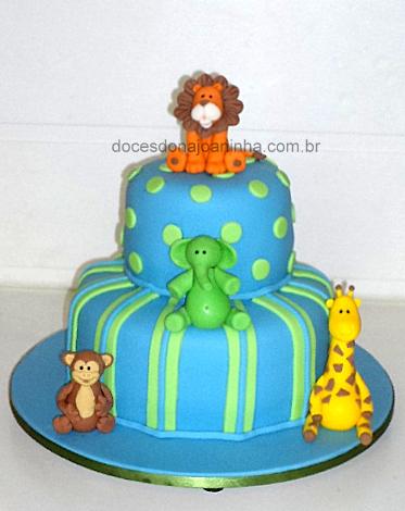 bolo decorado safári baby com leão girafa macaco elefante em azul e verde
