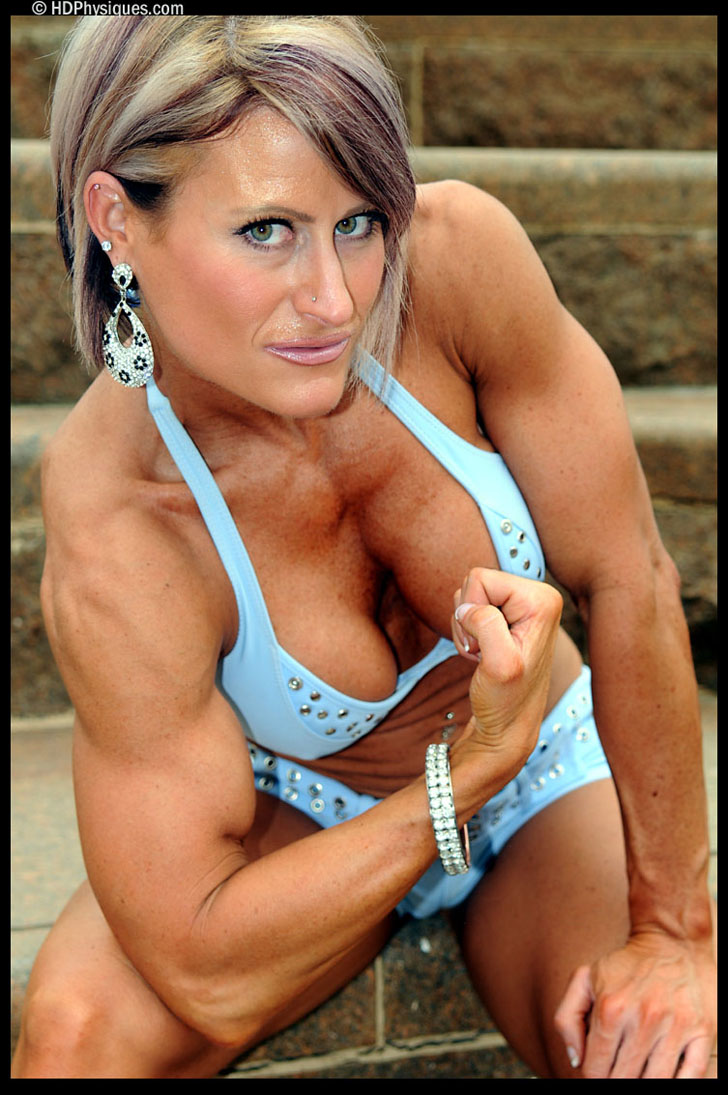 Miss Nikki Warner Flexing Her Bicep In A Blue Bikini