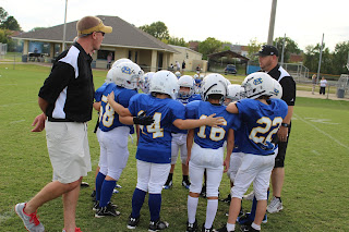 MONTGOMERY CATHOLIC'S TERMITE FOOTBALL TEAM LEARNING ALL ABOUT TEAMWORK. 1
