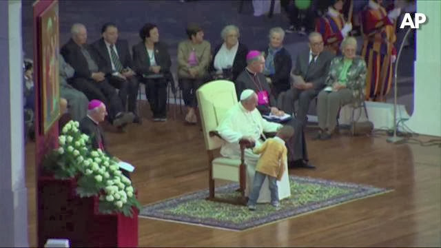 Pope Francis Upstaged By Young Boy