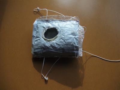DIY case for camera out of Tyvek and bubble wrap