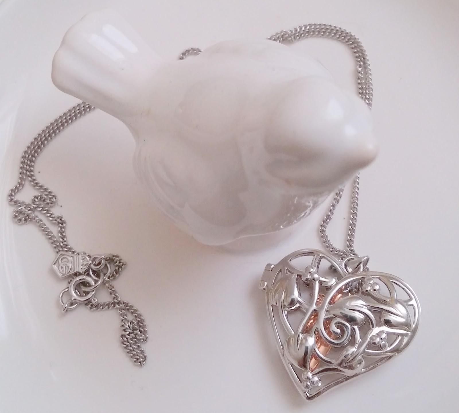 Clogau Gold Fairy Necklace on Bird dish