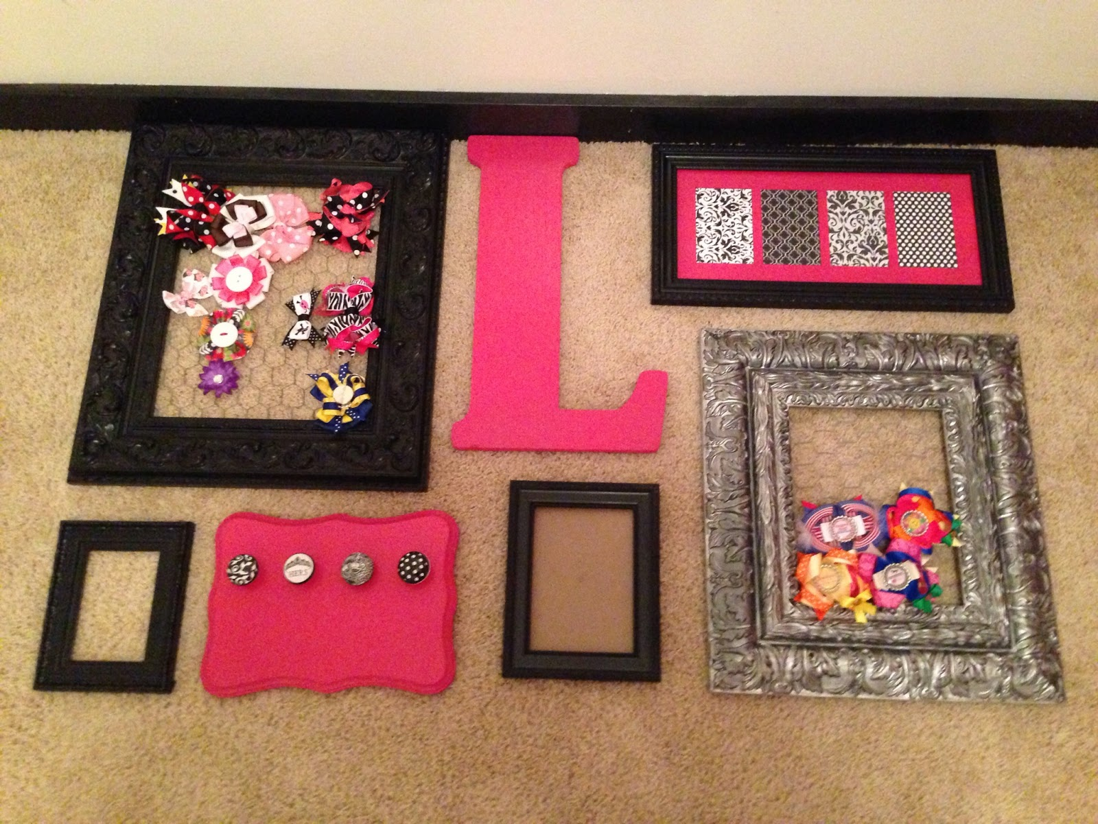 so i started by playing around with the frames i wanted on my wall by shifting them around on the ground originally i started with a much larger number of