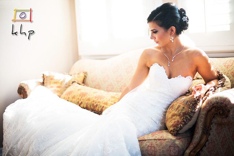 The bride on the couch by the window