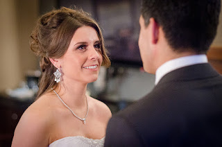 Katie looking at Christian during their wedding ceremony officiated by Patricia Stimac, Seattle Wedding Officiant