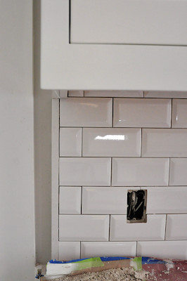 craftsman bungalow renovation. beveled subway tile backsplash with dark grout