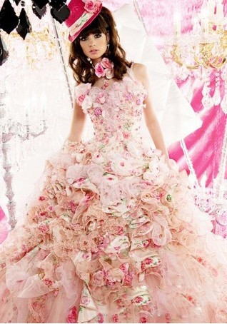 This pink wedding gown is densely decorated by flowers