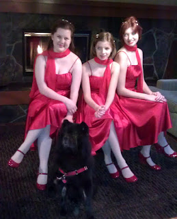 The bridesmaids are wearing red dresses and red shoes.