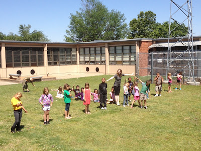 Students forming shape of biplane in courtyard.