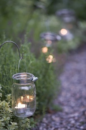http://indulgy.com/post/PPWcRb8MA1/mason-jar-with-hose-clamp-and-hook-a-candl#/do/page/1