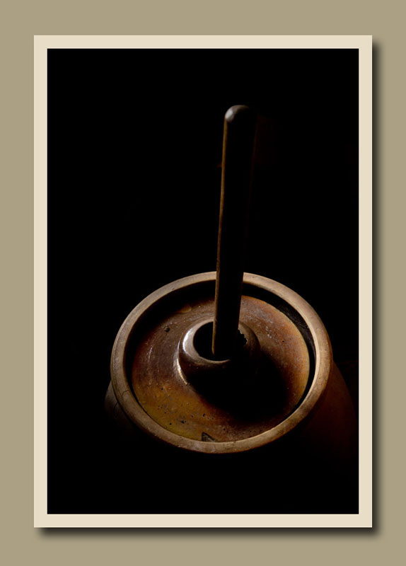 Light on the top of a butter churn at Black Creek Pioneer Village.  Holly Cawfield Photography