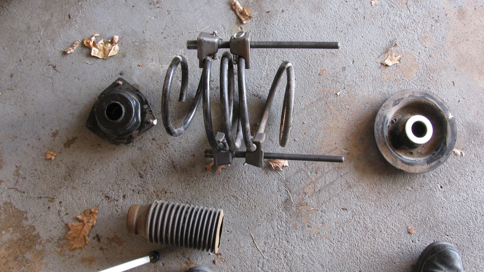 6 remove the strut components the cap the jonce bumper the spring the boot and the lower rubber isolator check the parts for condition and if ok clean