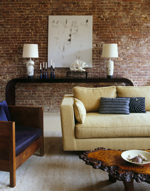Exposed brick and plaster walls for the interior design of for Exposed brick wall living room ideas
