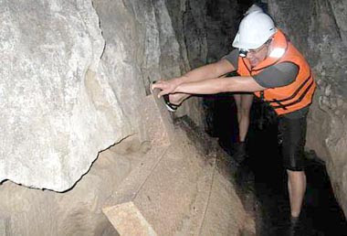 Must get to the bottom of it: Brian trying to lift one of the mining artefacts in the 6th Mile Tunnel.