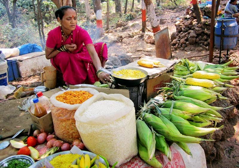 Woman vendor selling corn cobs