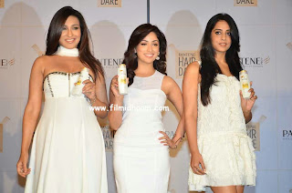 Yami Gautam in milky white gown with Rituparna Gosh and Mahi Gill Launching Pantene Shampoo