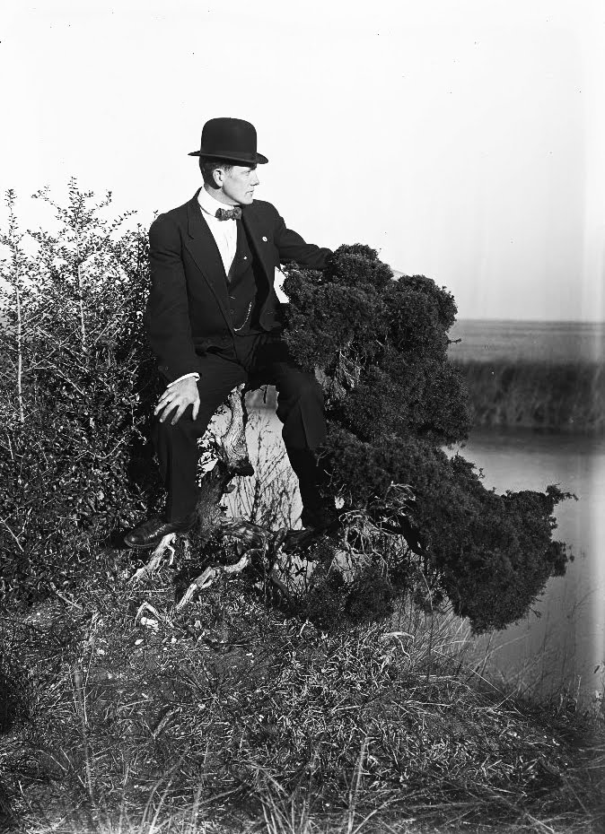 Huron H. Smith in suit, bow tie and bowler hat
