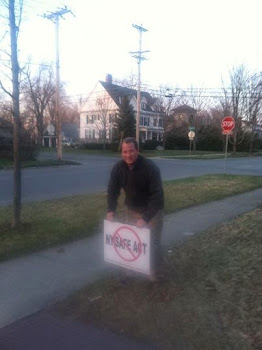 Matt Doheny Puts a SAFE Act Sign in His Lawn