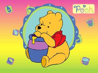 Winnie comiendo miel