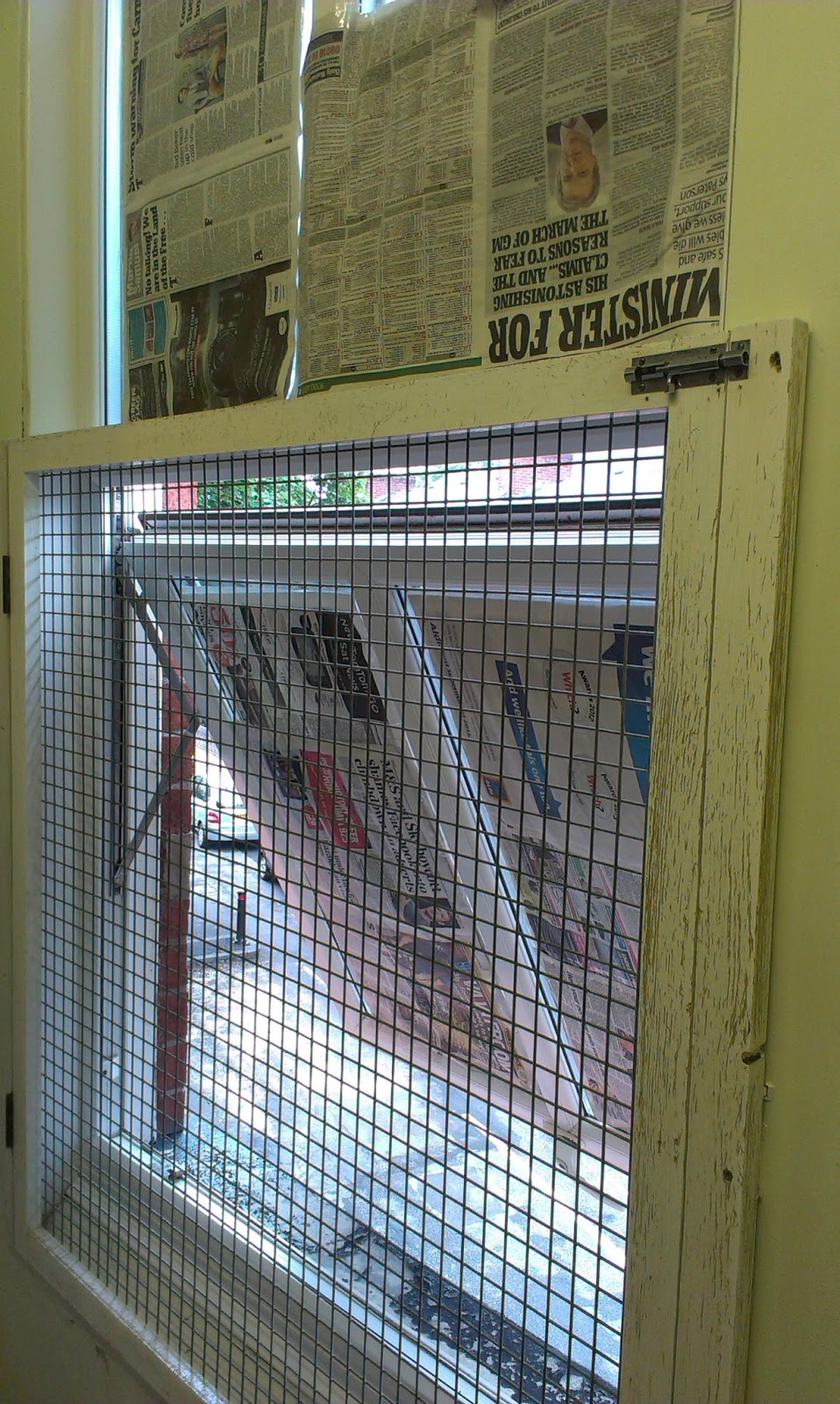 Open window with newspaper taped on