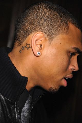 Three cute stars tattoo below a black man's ear
