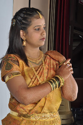 Bride getting ready for marriage in traditional silk saree.