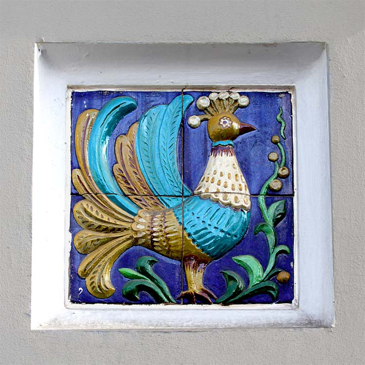 a tile mosaic of a peacock