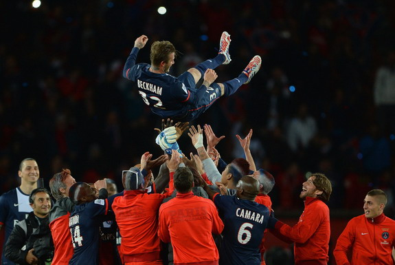 David Beckham is thrown in the air by his PSG teammates
