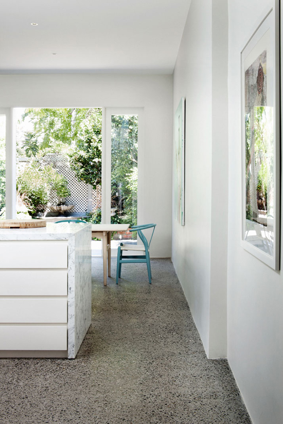 Turquoise wishbone chairs round the dining table and amazing mosaic floor in this australian home