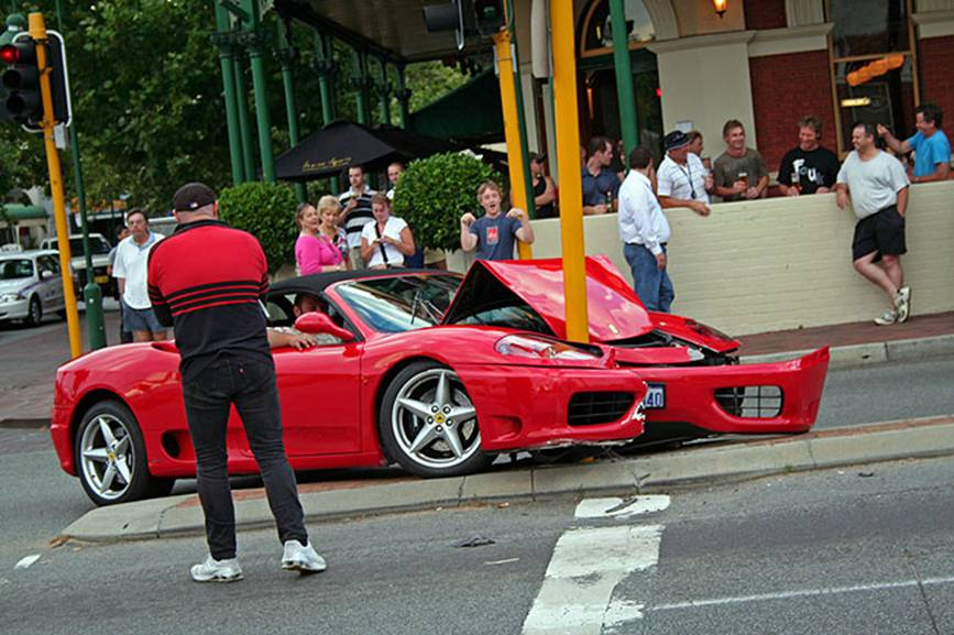 Turn Back Time Embarrassed Ferrari Driver Nudges Light