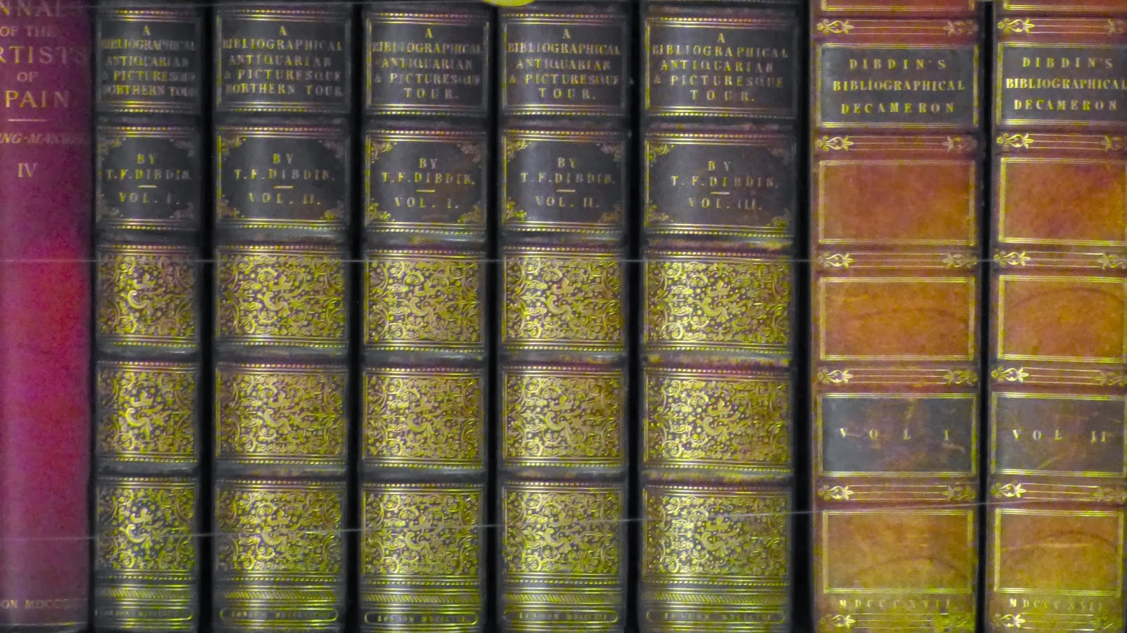 Books on the shelves at Knightshayes, Devon