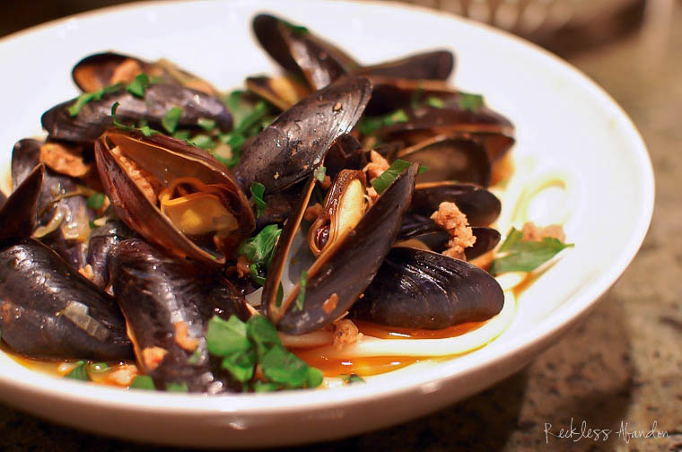 Steamed Mussels with Italian Sausage over Pasta