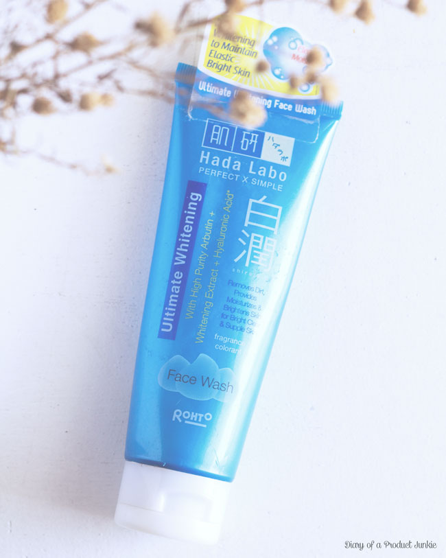 Hada labo ultimate whitening face wash on a white wooden plank