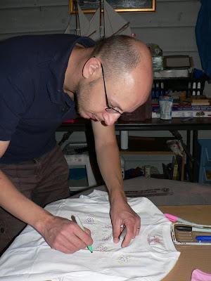 dad making diy tie-dyed shirts