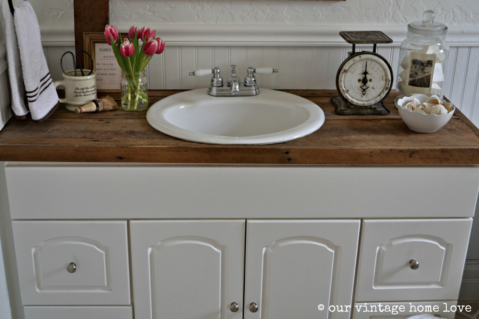 Our vintage home love farmhouse bathroom for Bathroom countertop accessories