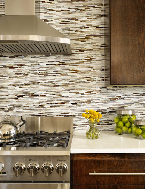 rectangular neutral tone tiles tie together the dark and light tones in this modern kitchen