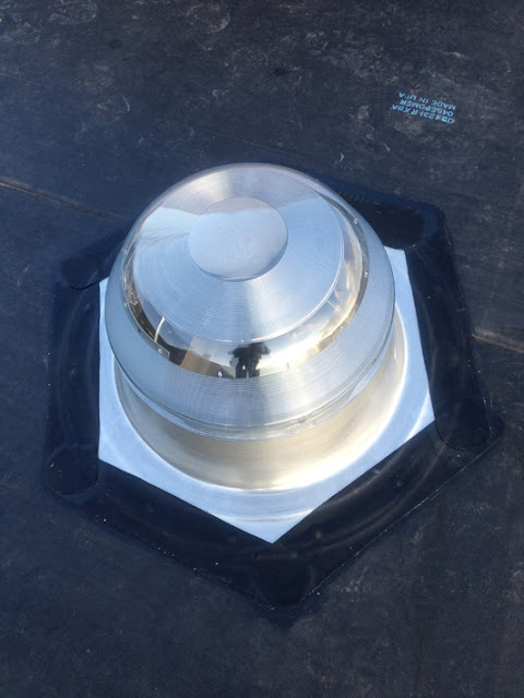 Solatube sealed to roof with silicone, joint then doubly waterproofed with rubber sealant tape
