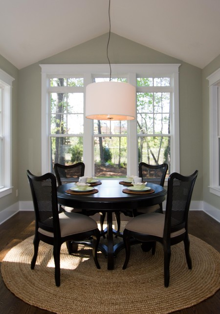 Awesome Black Chairs and Dark Round Dining Tables under the White Drum Pendant Light above Rounded Carpet