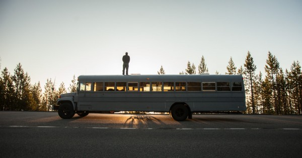 man on top of a bus
