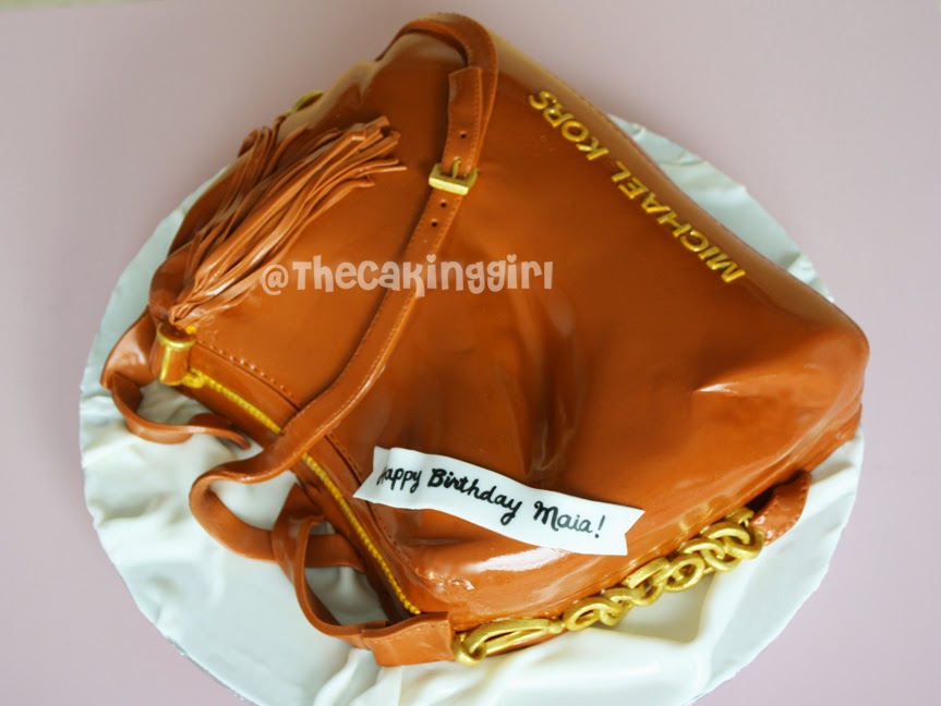 beige michael kors bag cake