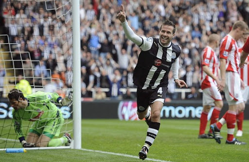 Newcastle midfielder Yohan Cabaye celebrates after scoring against Stoke
