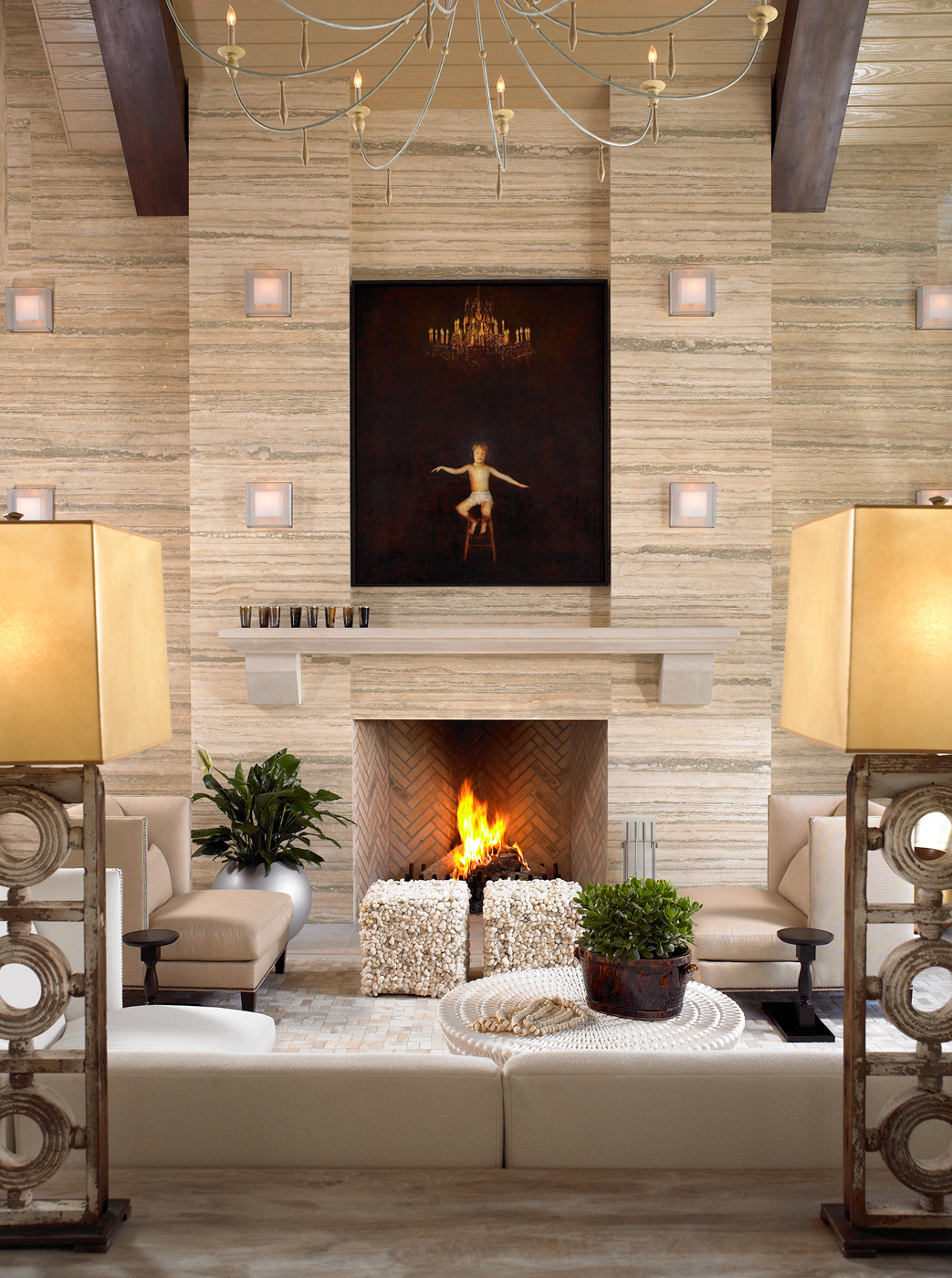 Highlighted art recessed within silver travertine solid walls title=