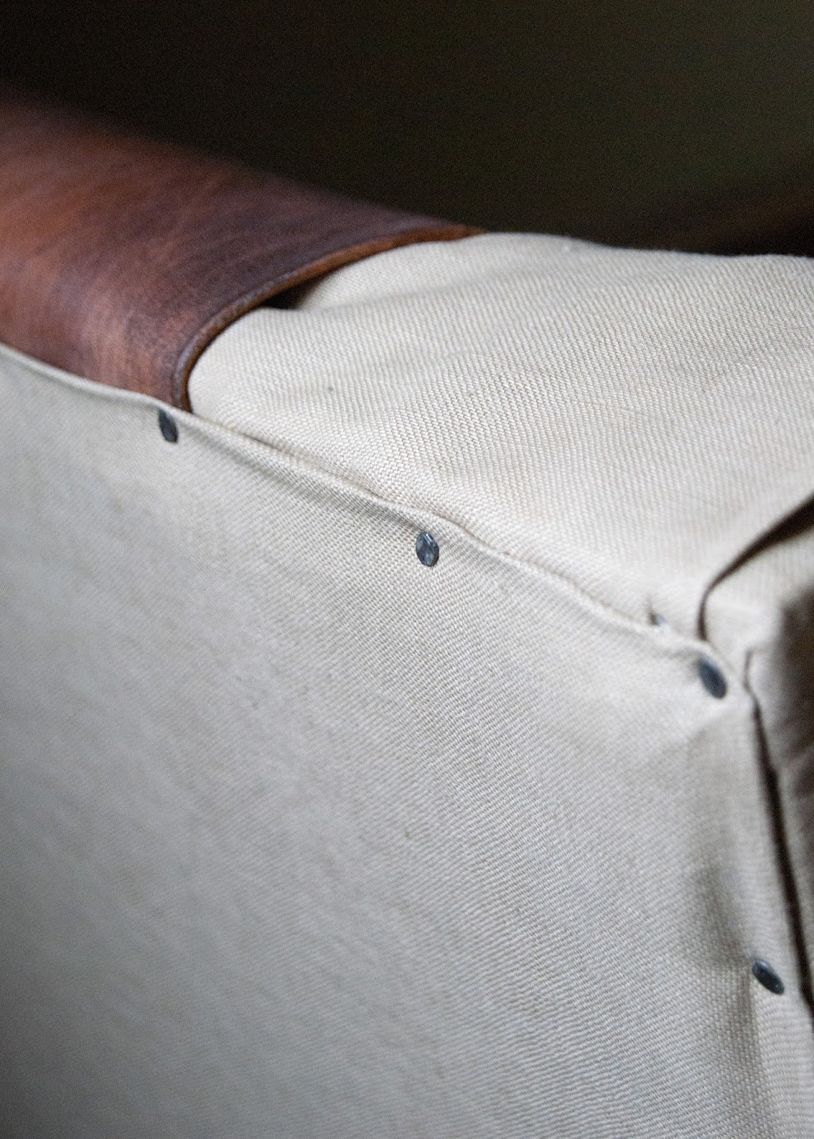 Close up of detail - leather, linen and nailheads.