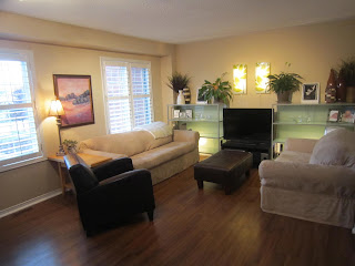 Living room makeover, warm colours, organized shelves, wood floors,